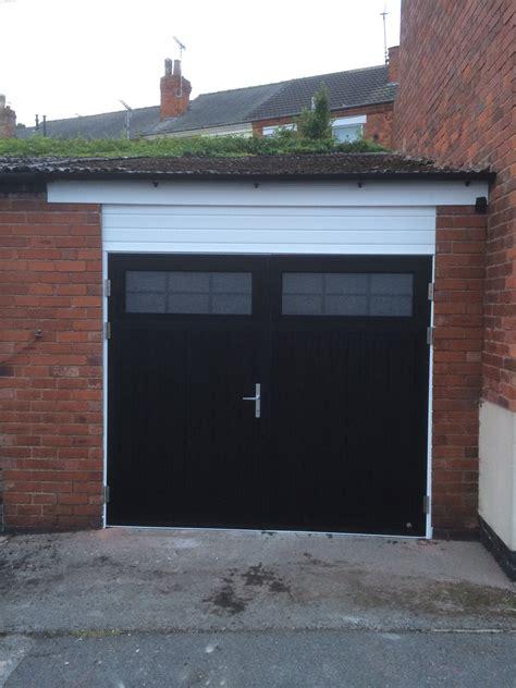 swinging garage door side hinged garage doors byron doors traditional style