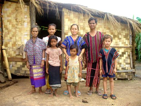 their home file brao family outside their home in laos jpg