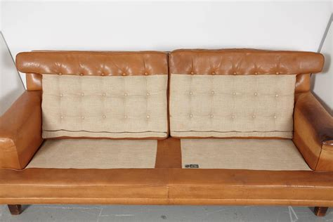 sofa without back cushions arne norell merkur sofa with pair of matching lounge