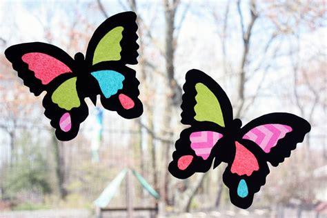 Construction Paper Butterfly Craft - moomama diy suncatcher butterflies