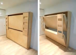 dumbo tuck bed packs two folding beds into one wall