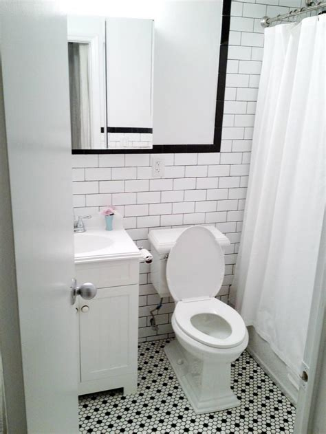 black and white bathroom tiles in a small bathroom white subway wall tiles with black grout black bullnose