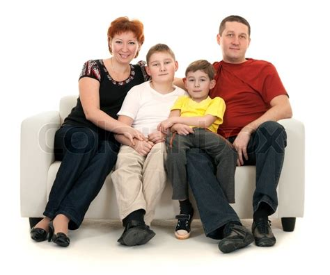 white couch with kids family of four on a sofa on a white background stock