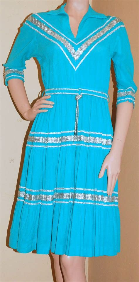 vintage dress in turquoise with silver rick rack by