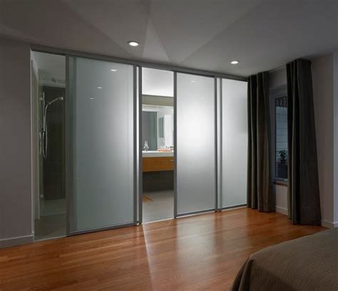 sliding bedroom door frosted glass sliding doors separate the contemporary bedroom from the sleek bathroom