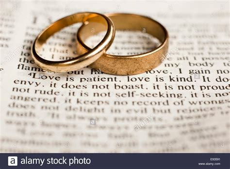 Bible Wedding And wedding rings on bible passage on stock photo