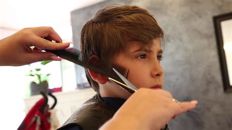 getting haircut at great clips young boy s hair being cut with hair cutting machine stock