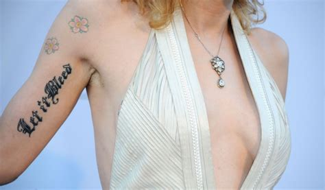 courtney love tattoos pictures amfar gala carpet arrivals