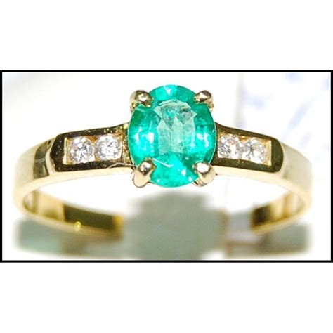 unique emerald solitaire 18k yellow gold ring rs0126