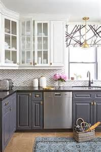 white cabinets and navy lower cabinets with black