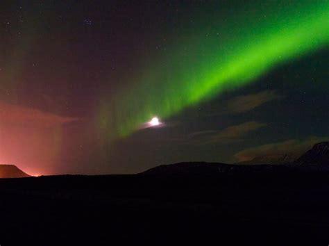 reykjavik iceland northern lights reykjavik turns off street lights to turn up the northern