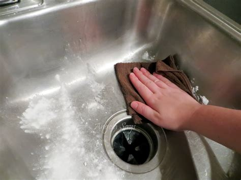 how to clean stainless steel sink with baking soda the secret to cleaning stainless steel sinks angela says