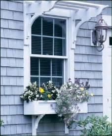 paneled window box with curved brackets wood window