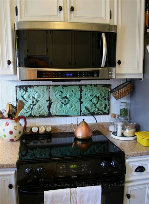 diy kitchen tile backsplash diy stove backsplash cool place to add some color i like the use of three large tiles the
