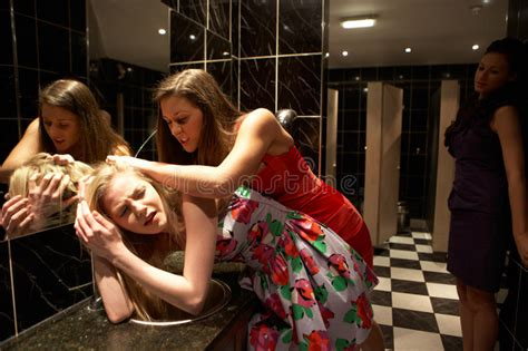 girl fight in bathroom two women having a fight in bathroom stock image image