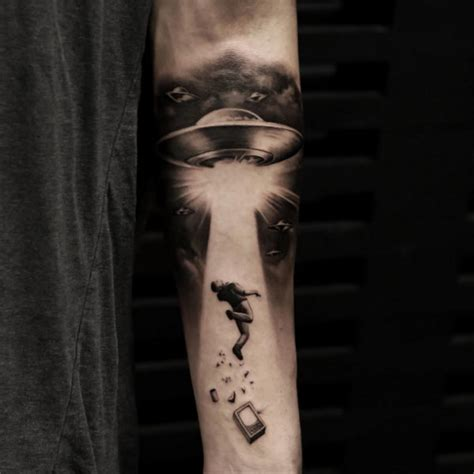 ufo forearm tattoo ideas tattoo designs