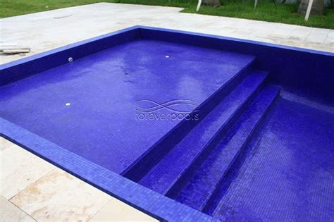 infinity pool with solid dark blue glass tile