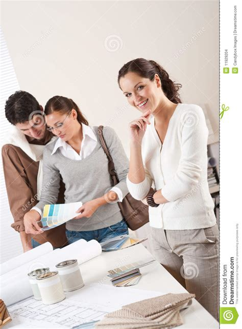 interior designer with two clients stock photo image 11929204