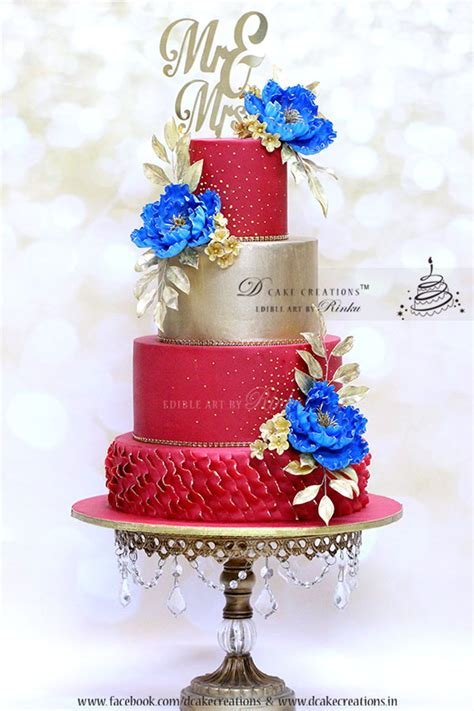 blue wedding cakes with flowers gold wedding cake with royal blue flowers