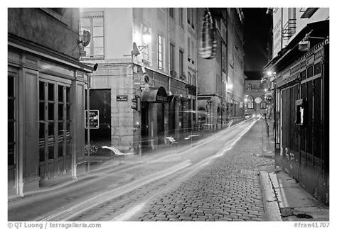 Sv3547 St Black And White black and white picture photo with light trails left by cars lyon