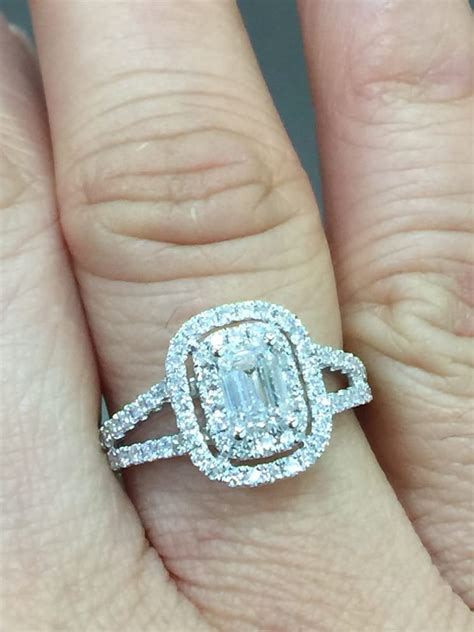 Can you believe this emerald, split shank with double halo