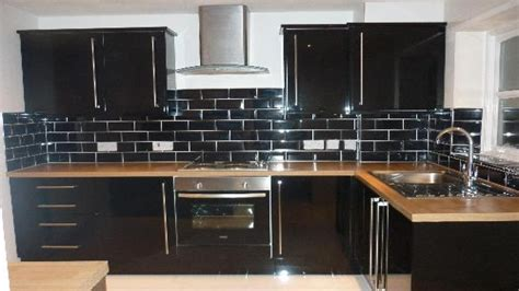black glass tiles for kitchen backsplashes black glass subway tile backsplash