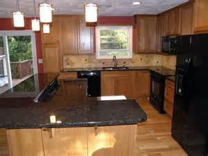 pictures of kitchens with oak cabinets and granite