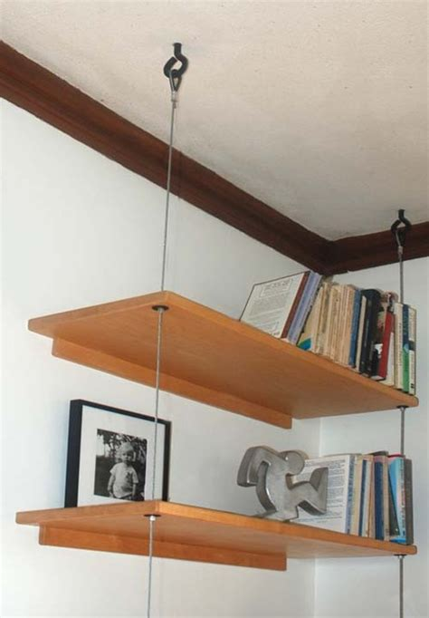 suspended bookshelves diy able suspended shelving 187 curbly diy design community