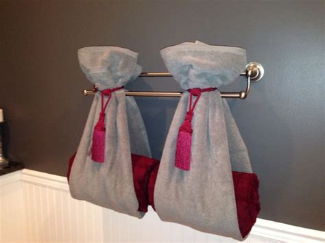 how to tie towels in bathroom a different way to hang towels using curtain tie backs