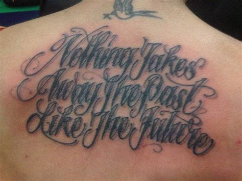 ruby roses tattoos back saying quot nothing takes away the past