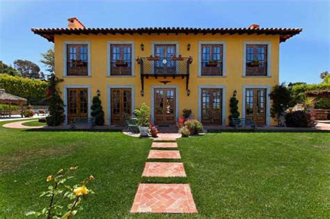 colonial hacienda style home with a touch of
