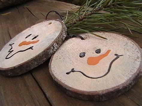 trees made out of wood snowmen made out of branches cut the branch and drill a