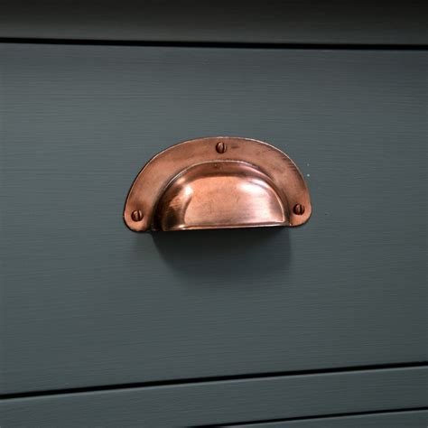 pressed copper cup handle aged