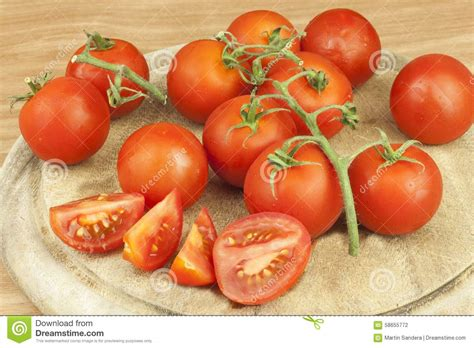 Ready Stock Heaven Cutting Food fresh tomatoes on the kitchen table tomatoes on a wooden