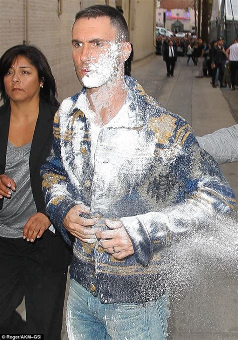 adam levine blasted in the face with sugar hollyscoop adam levine gets hit with powder bomb arriving at jimmy