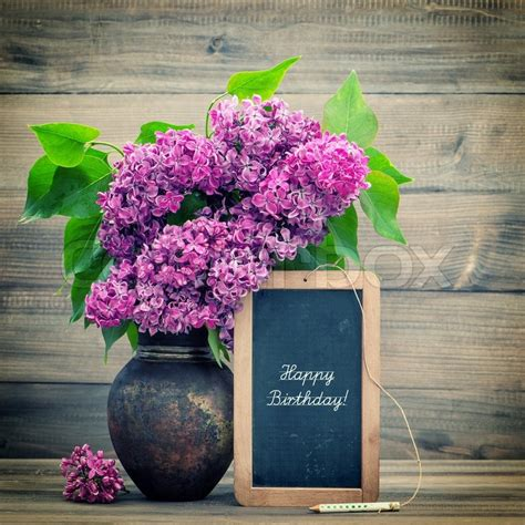 Vase Suppliers Bouquet Of Lilac Flowers On Wooden Background Blackboard