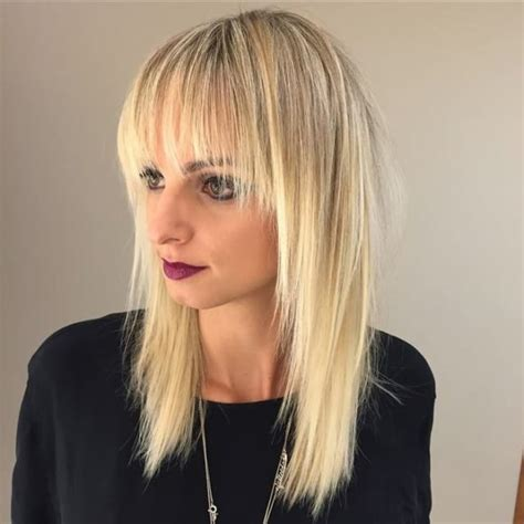 long bob with razored ends and side swept bangs medium women s long shaggy blonde hair with razor cut layers and
