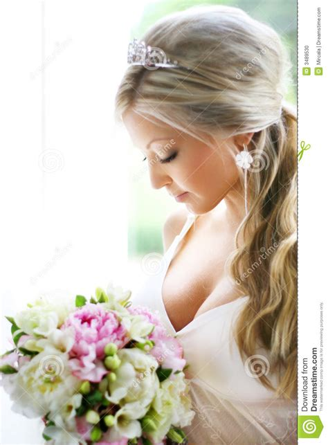 And Bridal Images by Looking At Bouquet Stock Photo Image Of Gazing