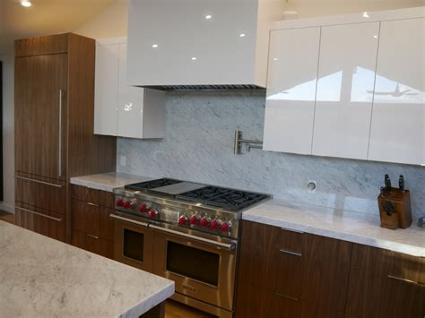 how to finish the top of kitchen cabinets kenmore modern kitchen remodel with 3 cabinet finishes