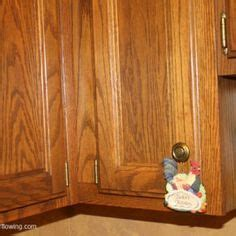cleaning wood cabinets on cleaning scrubs and