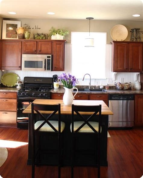 what to put on top of your kitchen cabinets what to put on top of kitchen cabinets savae org