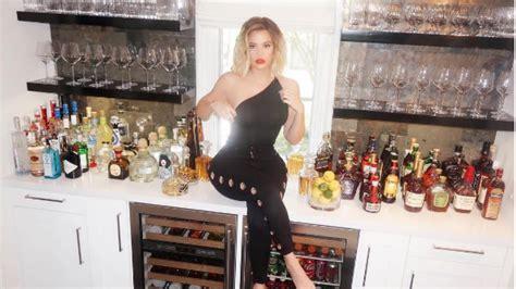 khloe kardashian poses   bar  model good american