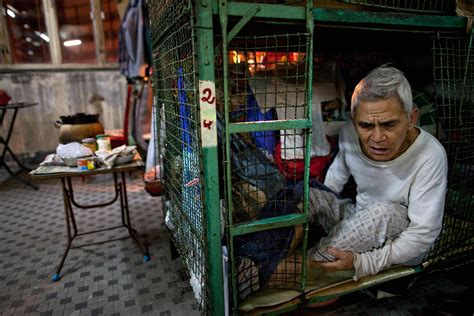 side of hong kong boom displayed by poor in cages