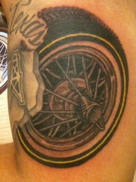 tire tattoo by joey rodriguez tattoonow