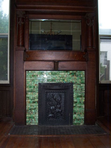 precast mantelsfireplace surroundsiron fireplace doors green mosaic tile fireplace surround plus wood mantel