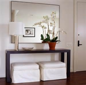 Entryway Table And Mirror Slipcovered White Ottomans And Modern Wood Console Table With Chrome L And Large Wall Mirror