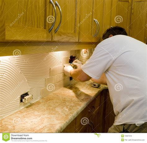 Installing Ceramic Tile Backsplash In Kitchen Ceramic Tile Installation On Kitchen Backsplash 12 Stock Photo Image 13321312