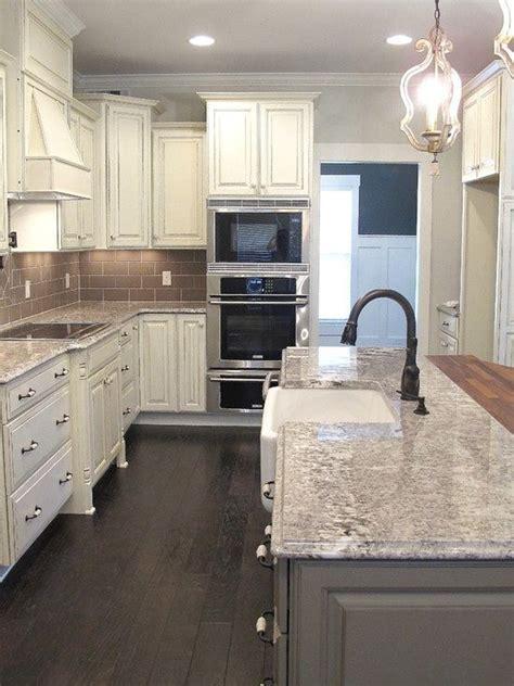 gray distressed kitchen cabinets with marble herringbone white glazed cabinets minka lighting bianco antico