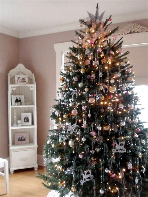 christmas tree with vintage ornaments and tinsel a photo