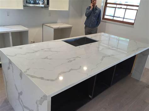 Non Toxic Kitchen Cabinets calacatta gold quartz countertop mitered edeg and island